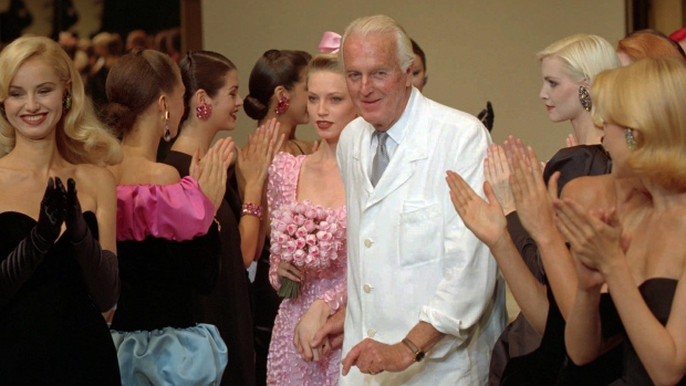 French designer Hubert de Givenchy is applauded by his models after what would be one of his final haute couture fashion collection in Paris on July 11, 1995. (AP / Lionel Cironneau)