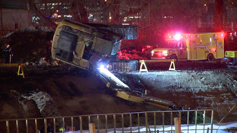 A backhoe tipped over while digging a trench near the Lachine Canal and Monk Blvd. on March 13, 2018 (CTV Montreal/Cosmo Santamaria)