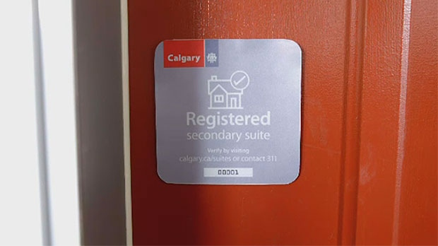 Stickers identify those suites that are listed under the city's Suites Registry Program.