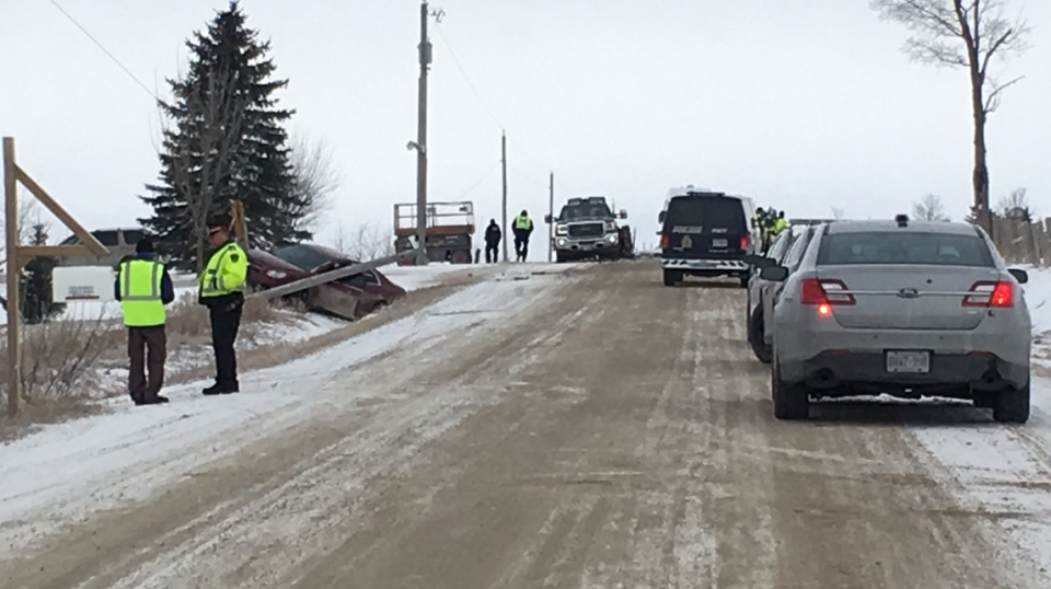 One person was killed when a car hit a stopped trailer on Boomer Line in Wellesley Township on Tuesday, March 13, 2018. (Emma Ens / CTV Kitchener)