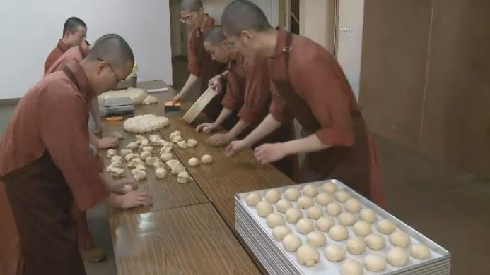 Members of the Great Enlightenment Buddhist Society make 1,200 of their famous bread rolls every week and distribute them to seniors, schools, and local food banks.