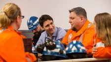 Trudeau with steel workers