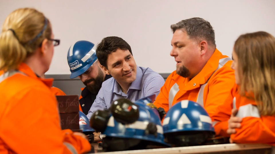 Prime Minister Justin Trudeau speaks with workers during a visit to Stelco Hamilton Works in Hamilton Ont., Tuesday, March 13, 2018. THE CANADIAN PRESS/Tara Walton