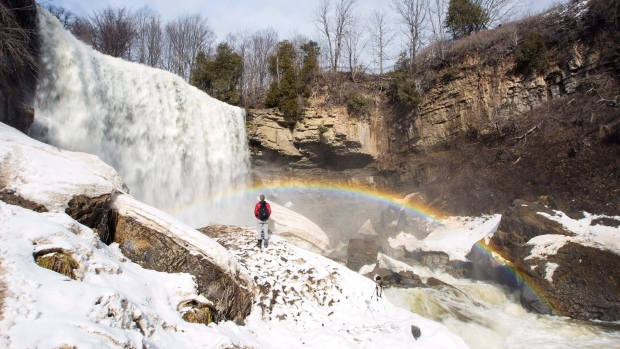 A young man does a self-portrait at Webster Falls in Hamilton on Friday, March 2, 2018. (THE CANADIAN PRESS / Peter Power)