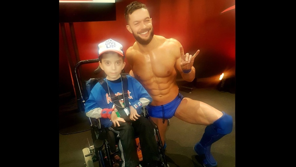 Michael Ginassio meets WWE superstar Finn Balor at Little Caesars Arena in Detroit on March 12, 2018.  (Photo Courtesy of Sandra Giannasio)