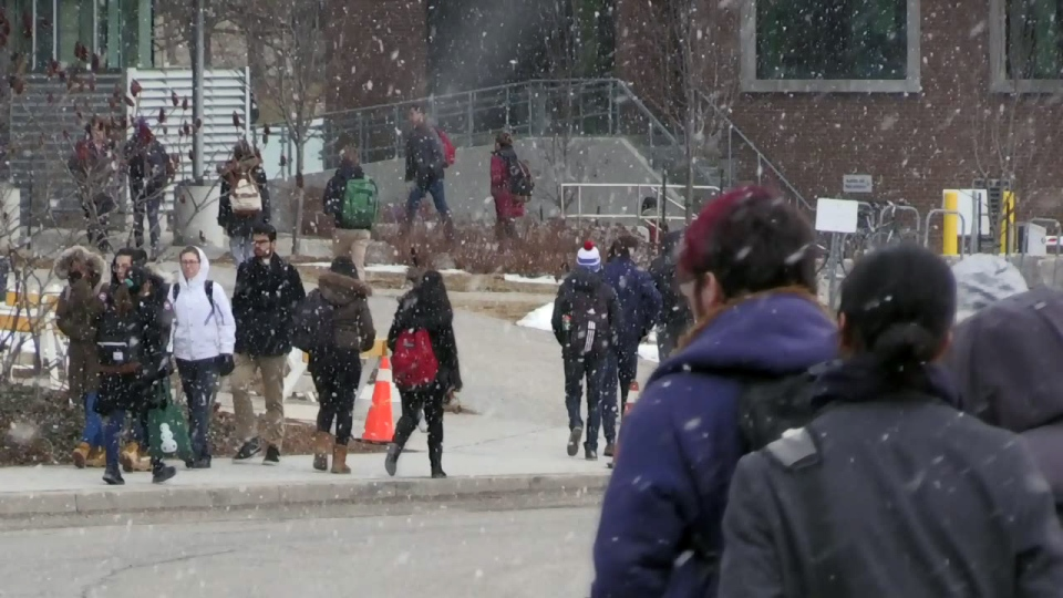 Students walk on the University of Waterloo campus on Tuesday, March 13, 2018.