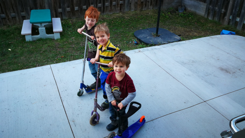 Three of Morgan DeCairos DeBoer's four young boys, 6-year-old Phoenix, 4-year-old Quinn, 2-year-old Gabriel, play in the family's backyard. (Handout)