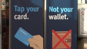 A TransLink sign warning riders to tap their Compass Cards and not their whole wallet is seen in this image from March 2018.