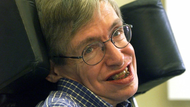 Professor Stephen Hawking smiles during a news conference at the University of Potsdam, near Berlin, Germany, on July 21, 1999. (Markus Schreiber / AP)