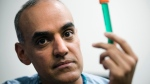 Surgeon Dr. Sunil Singhal poses for a photograph with a vial of fluorescent dye at the Hospital of the University of Pennsylvania in Philadelphia, Tuesday, Jan. 23, 2018. (AP Photo/Matt Rourke)