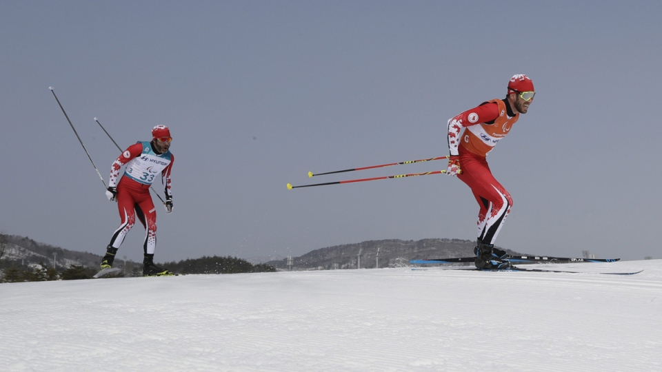 Brian Mckeever, left, and guide Graham Nishikawa in the men's 20km free, visually impaired, cross-country skiing at the 2018 Winter Paralympics in Pyeongchang, South Korea, on March 12, 2018. (Lee Jin-man / AP)