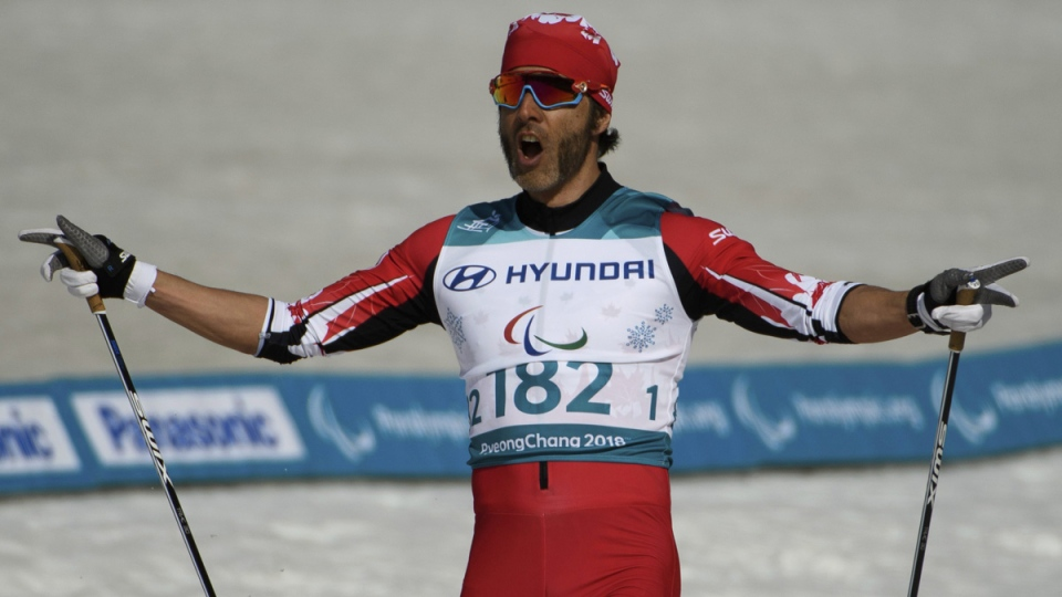 Brian McKeever celebrates his victory in the Cross-Country Skiing Visually Impaired Men's 1.5km Sprint Classic Final at the Alpensia Biathlon Centre in Pyeongchang, on March 14, 2018. (Thomas Lovelock/OIS/IOC via AP)