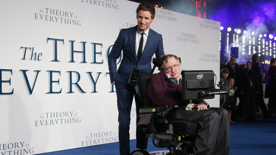 Stephen Hawking, right, and 'The Theory of Everything' star Eddie Redmayne at the Odeon in Leicester Square, central London, on Dec. 9, 2014. (Joel Ryan / Invision / AP)