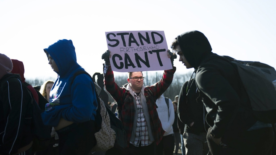 Cherry Hill High School West senior Zach Permar, 18, marches with fellow students during a walkout on March 14, 2018 in Cherry Hill, N.J. (Joe Lamberti / Camden Courier-Post via AP)