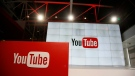 This Oct. 21, 2015, file photo shows signage inside the YouTube Space LA offices in Los Angeles.YouTube says it's cracking down on conspiracy videos. (AP Photo/Danny Moloshok, File)