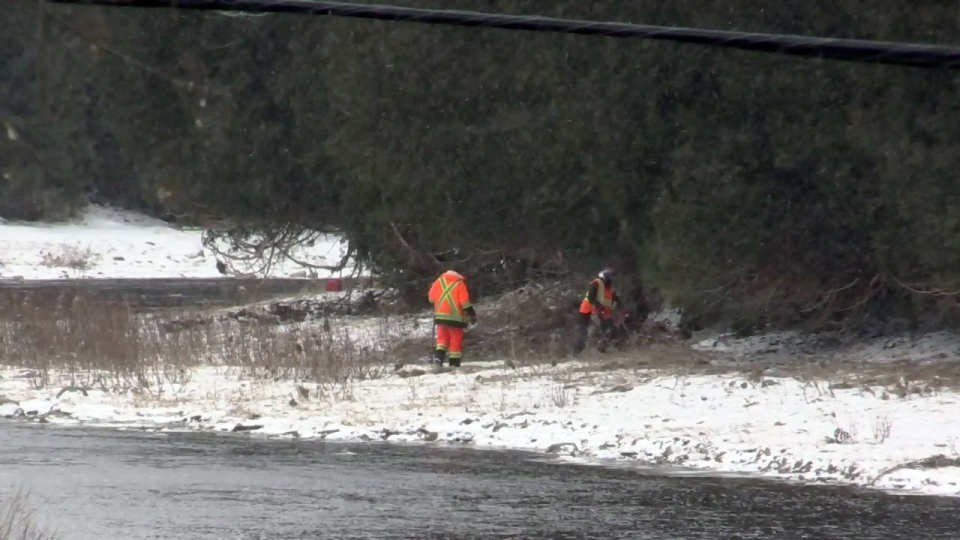 Volunteers search the banks of the Grand River for Kaden Young on Wednesday, March 14, 2018.