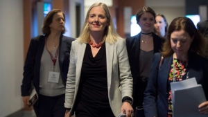 Minister of Environment and Climate Change, Catherine McKenna, centre, arrives to make an announcement in Vancouver, Wednesday, March 14, 2018. THE CANADIAN PRESS/Jonathan Hayward