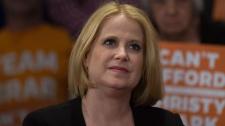 NDP MLA Lisa Beare listens to John Horgan
