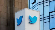 This Oct. 26, 2016 file photo shows a Twitter sign outside company headquarters in San Francisco. (AP Photo/Jeff Chiu, File)
