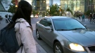 A woman awaiting a vehicle from the ride-sharing app DriveHER in Toronto is seen. (DriveHER)