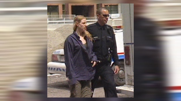 2009 video still of Stephanie Martens being escorted by a CPS member after being arrested near Langdon