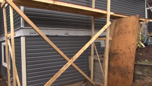 Scaffolding remains at Kristin Parsons' home after she says the renovator she hired walked off the job. (CTV)