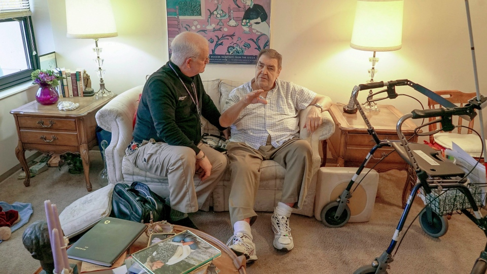 Nurse practitioner Dwayne Dobschuetz, left, visits patient Marvin Shimp, at Shimp's home in Chicago on Jan. 10, 2018. (Teresa Crawford/AP Photo)