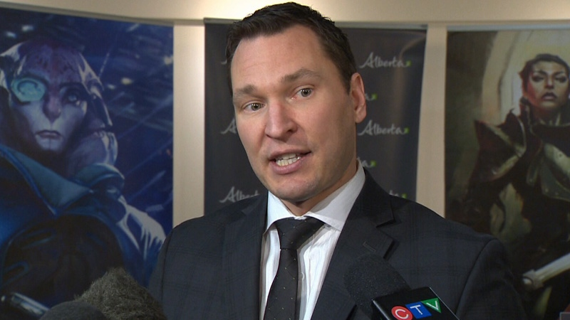 Deron Bilous speaks to reporters on Thursday, March 15, 2018.
