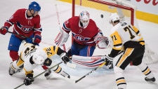 Pittsburgh Penguins right wing Patric Hornqvist (72) scores against Montreal Canadiens goaltender Antti Niemi (37) in Montreal, Thursday, March 15, 2018. THE CANADIAN PRESS/Graham Hughes