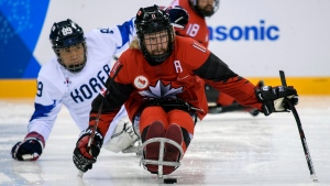Adam Dixon, of Canada, moves the puck against South Korea during a semifinal ice hockey match at the Pyeongchang Paralympics in Gangneung, South Korea, Thursday, March 15, 2018. (Joel Marklund/OIS/IOC via AP)