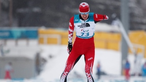 Mark Arendz of Canada races towards the finish line in the Biathlon Standing Men's 15km at the Alpensia Biathlon Centre in Pyeongchang, South Korea at the Paralympic Winter Games Friday, March 16, 2018. (Simon Bruty/OIS/IOC via AP)