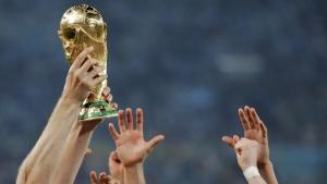 Reaching for the World Cup trophy at the Maracana Stadium in Rio de Janeiro, Brazil, July 13, 2014. (Matthias Schrader / AP)