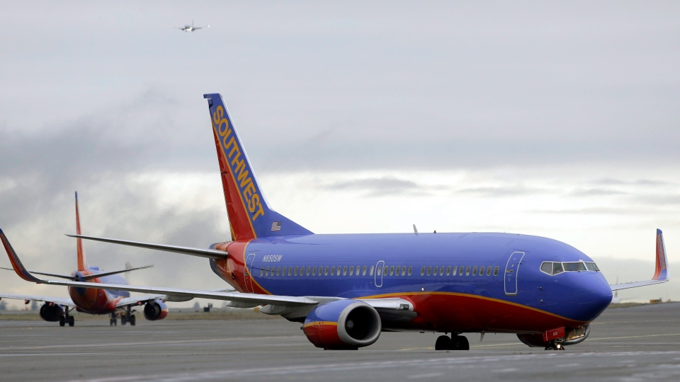 In this Tuesday, Jan. 26, 2016, file photo, a Southwest Airlines Boeing 737 taxis to a gate at Seattle-Tacoma International Airport in Seattle. (AP Photo/Ted S. Warren, File)