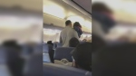The man and his two-year-old daughter were escorted off the flight on March 14, 2018.