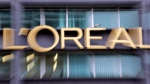 The logo of cosmetics group L'Oreal is pictured with a zoom effect during a visit at L'Oreal Headquarters in Clichy, north outskirts of Paris, France, on Nov. 3, 2014. THE CANADIAN PRESS/AP-Francois Mori
