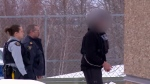 The La Loche shooter is walked into court in La Loche on Feb. 23, 2018.