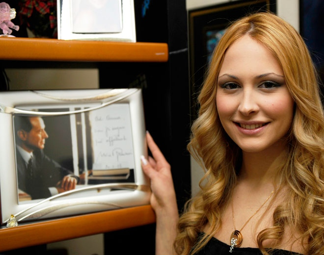 18-year-old Noemi Letizia poses with a portrait of Silvio Berlusconi in her home in Naples, Italy, on Tuesday, April 28, 2009.   (AP / Franco Castan)