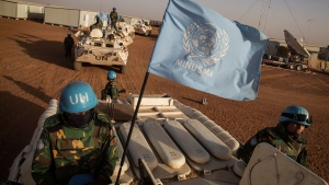 In this Feb. 25, 2015 photo provided by the United Nations, UN peacekeepers from Bangladesh arrive at the Niger Battalion Base in Ansongo, in eastern Mali. (Marco Dormino/United Nations via AP)
