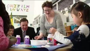 Saskatchewan Minister of Education Gordon Wyant creates a craft with kids.