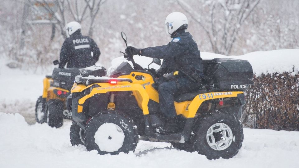 Montreal police officers head out to search for missing boy Ariel Jeffrey Kouakou in Montreal, Wednesday, March 14, 2018. THE CANADIAN PRESS/Graham Hughes