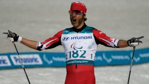 In this file photo, Canada's Brian McKeever celebrates his victory in the Cross-Country Skiing Visually Impaired Men's 1.5km Sprint Classic Final at the Alpensia Biathlon Centre in Pyeongchang, South Korea, at the Pyeongchang 2018 Paralympic Winter Games Wednesday, March 14, 2018. (Thomas Lovelock / OIS / IOC via AP)