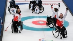 Canada's Mark Ideson, bottom left, Marie Wright and Dennis Thiessen, bottom right, celebrate victory in the Wheelchair Curling Bronze Medal Game between South Korea and Canada at the Gangneung Curling Centre in Gangneung, South Korea at the 2018 Winter Paralympics Saturday, March 17, 2018. (Joel Marklund/OIS/IOC via AP)