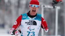 Mark Arendz CAN celebrates victory in the Biathlon Standing Men's 15km at the 2018 Paralympic Winter Games at the Alpensia Biathlon Centre in Pyeongchang, South Korea, Friday, March 16, 2018. THE CANADIAN PRESS/AP-HO, IOC/OIS, Simon Bruty
