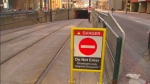 A sign warns motorists not to drive into a streetcar tunnel on Queens Quay near Bay Street.
