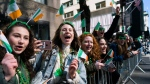 "Spectators cheer as they take part in the St. Patrick's Day parade Saturday, March 17, 2018, in New York. Several bagpipe bands led a parade made up of over 100 marching bands after Democratic Gov. Andrew Cuomo spoke briefly, calling it a ""day of inclusion"" and adding: ""We're all immigrants."" (AP Photo/Craig Ruttle)"