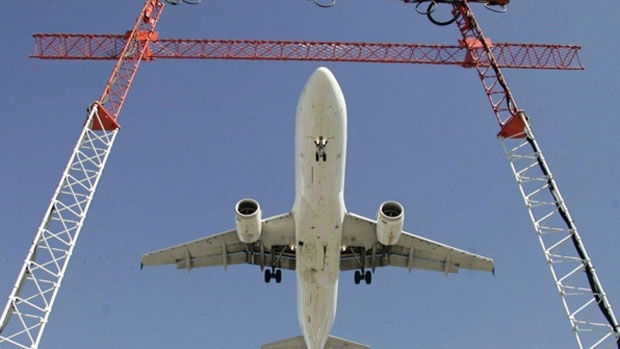 An Air Canada flight makes its final approach as it lands at Pearson International Airport in Toronto on Sept. 30, 2004. (THE CANADIAN PRESS/Adrian Wyld)