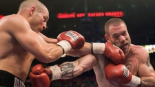 Adrian Diaconu, right, lands a left to the jaw of David Whittom during their light heavyweight bout in Montreal Saturday, April 4, 2009. Journeyman boxer Whittom remains in an induced coma at the Saint John Regional Hospital following surgery to treat bleeding on the brain after a knockout loss. (THE CANADIAN PRESS/Ryan Remiorz)