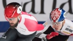 Charles Hamelin, left, of Canada, takes a turn ahead of Lim Hyo Jun, of South Korea, during the 1500-metre final race at the ISU world short-track speedskating championships in Montreal, Saturday, March 17, 2018. THE CANADIAN PRESS/Graham Hughes