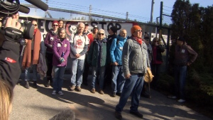 Protesters gather outside Kinder Morgan's Westridge Marine Terminal in Burnaby, B.C., despite a court injunction that was granted to the company this week. March 17, 2018.