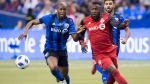 Montreal Impact defender Thomas Meilleur-Giguere, left, challenges Toronto FC forward Jozy Altidore, during first half MLS action in Montreal, Saturday, March 17, 2018. THE CANADIAN PRESS/Ryan Remiorz